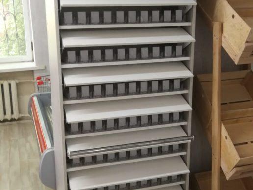 Шкаф для сигарет с синхронными шторками